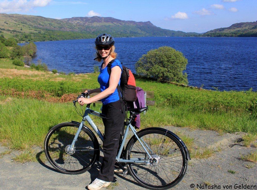 Natasha cycling Loch Katrine, Scotland
