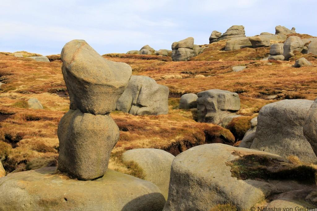 Gritstone formations on Kinder Scout, hiking the Peak District